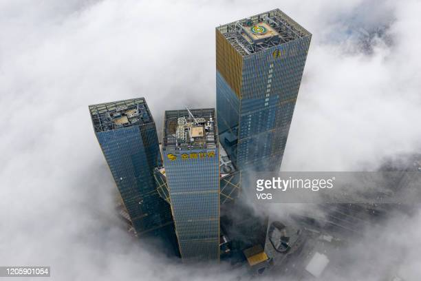 Aerial view of buildings enveloped in thick fog on February 13, 2020 in Nanjing, Jiangsu Province of China.