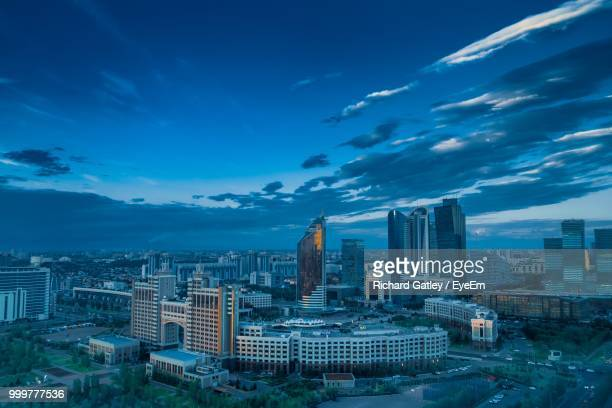 aerial view of buildings in city against blue sky - astana stock photos and pictures