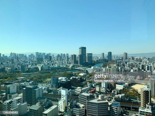 aerial view of buildings in city against clear blue sky - 大阪 ストックフォトと画像