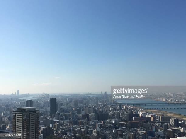 aerial view of buildings in city against clear sky - 大分県 ストックフォトと画像