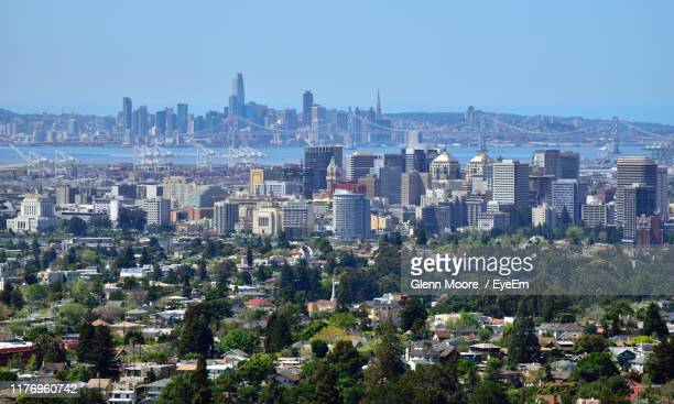 aerial view of buildings in city against clear sky - oakland california skyline stock pictures, royalty-free photos & images