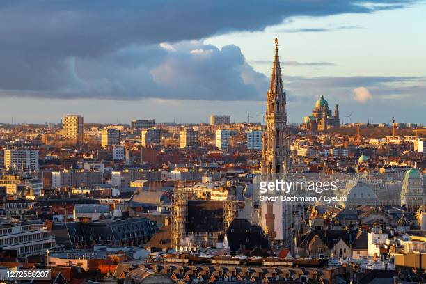 aerial view of buildings in city against cloudy sky - brussels capital region stock pictures, royalty-free photos & images