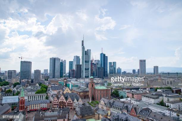 aerial view of buildings in city against cloudy sky - frankfurt am main stock-fotos und bilder