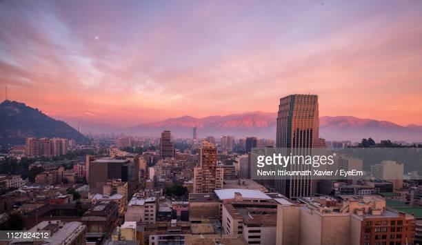 aerial view of buildings in city against sky during sunset - santiago chile fotografías e imágenes de stock