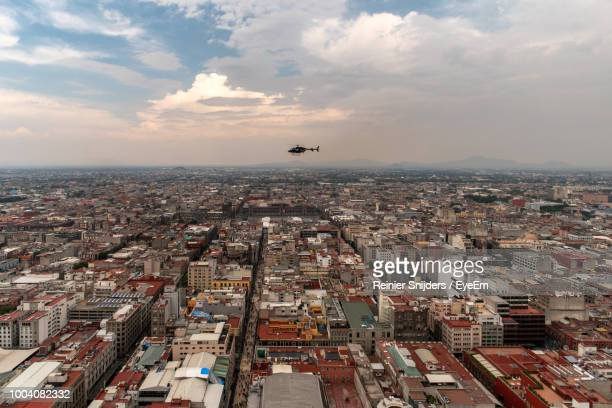 aerial view of buildings in city against sky - mexico city aerial stock pictures, royalty-free photos & images
