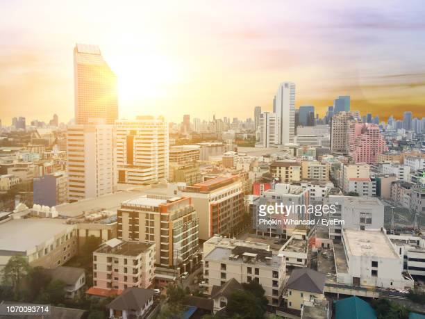 aerial view of buildings in city against sky - thai mueang photos et images de collection