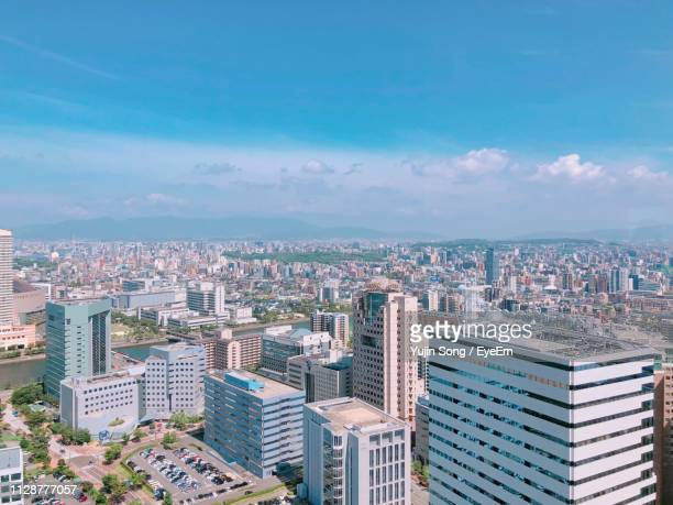 aerial view of buildings in city against sky - 福岡県 ストックフォトと画像