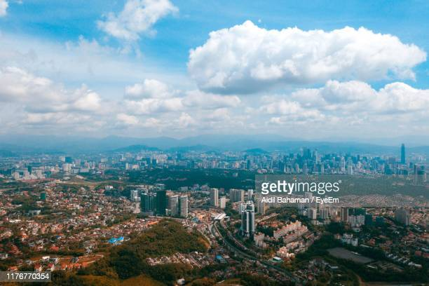 aerial view of buildings in city against sky - shah alam stock photos and pictures