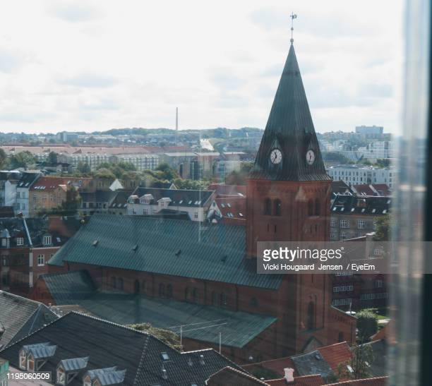 aerial view of buildings in city against sky - aalborg stock pictures, royalty-free photos & images