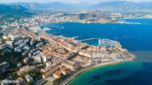aerial view of buildings in city by sea - ajaccio stock photos and pictures