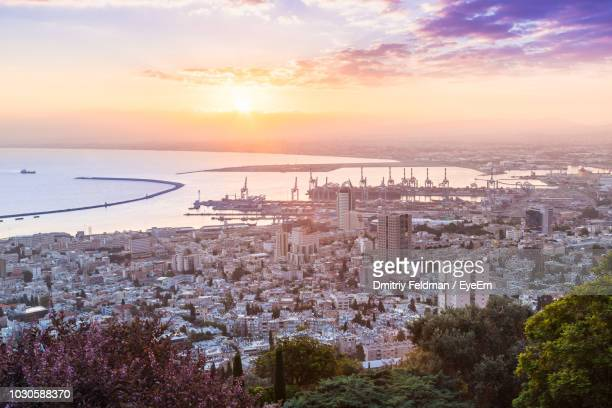 aerial view of buildings in city during sunset - haifa stock pictures, royalty-free photos & images