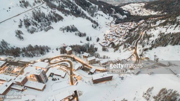 aerial view of buildings in city during winter - savoie stock pictures, royalty-free photos & images