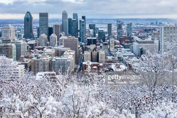 aerial view of buildings in city during winter - montréal stock pictures, royalty-free photos & images
