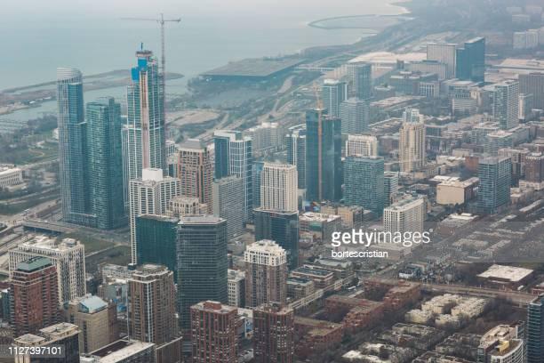 aerial view of buildings in city - bortes foto e immagini stock