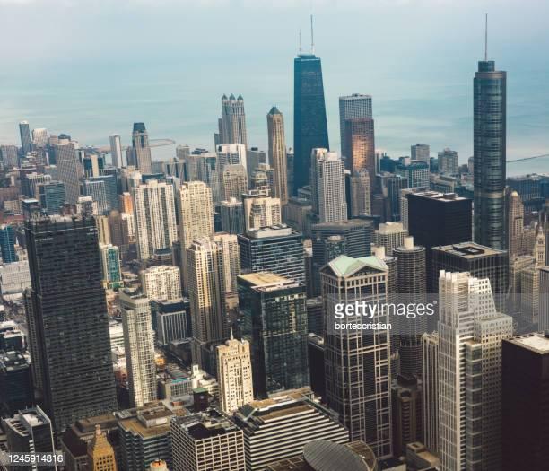 aerial view of buildings in city - bortes stockfoto's en -beelden