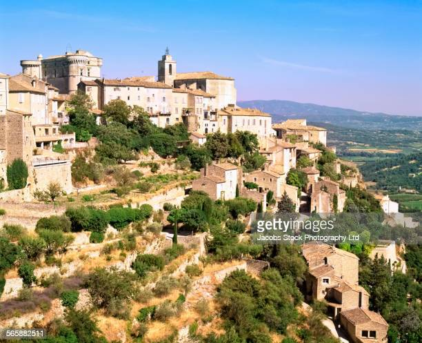 Aerial view of buildings on rural hillside, Gordes, Provence, France