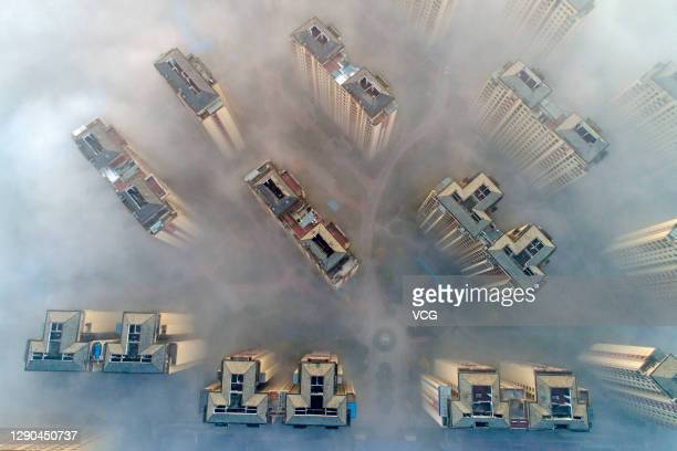 Aerial view of buildings shrouded in fog on December 10, 2020 in Xiangyang, Hubei Province of China.