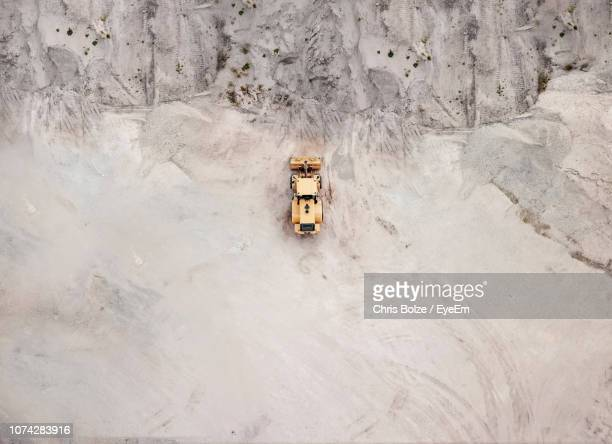 aerial view of bulldozer on sand - gruva bildbanksfoton och bilder