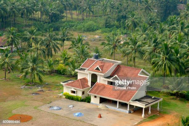 Aerial view of bungalow surrounded by coconut trees, Karkal district, Mangalore, South Kanara, Karnataka, India