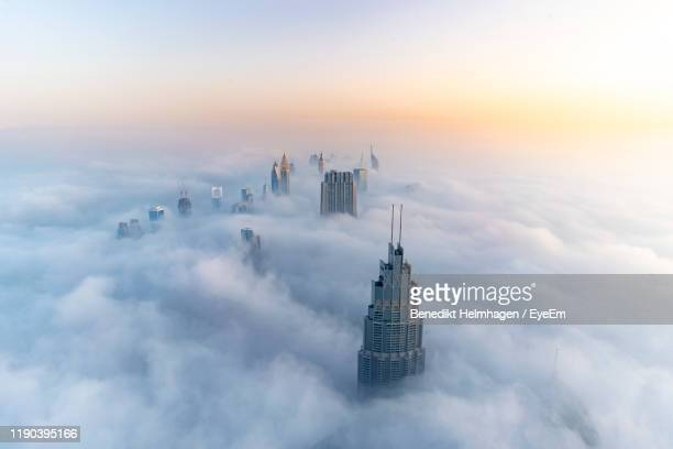 aerial view of burj khalifa against cloudy sky - gulf countries stock pictures, royalty-free photos & images
