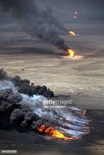 Aerial view of burning oil wells and pools Kuwait 1991