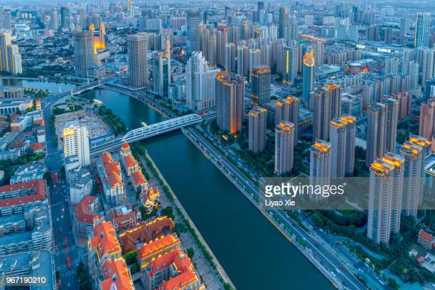 aerial view of business building along the river - liyao xie ストックフォトと画像