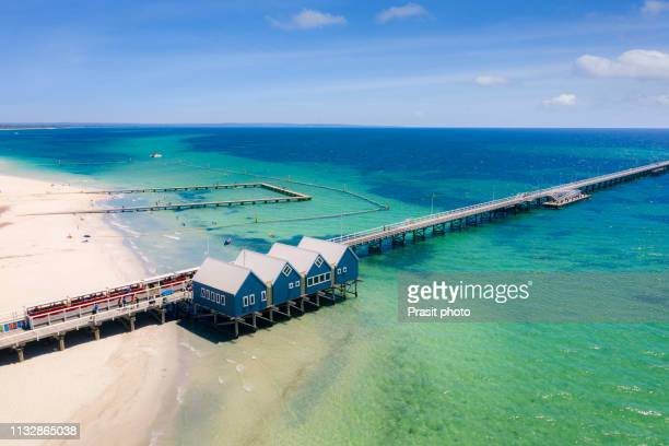 aerial view of busselton jetty on a sunny day with tourists in front of souvenir shop in busselton, western australia, australia. - perth australia stock photos and pictures