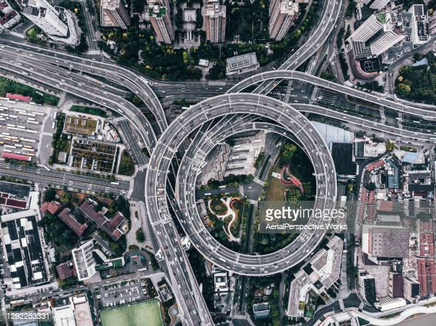 aerial view of busy road intersection - science and technology stock pictures, royalty-free photos & images