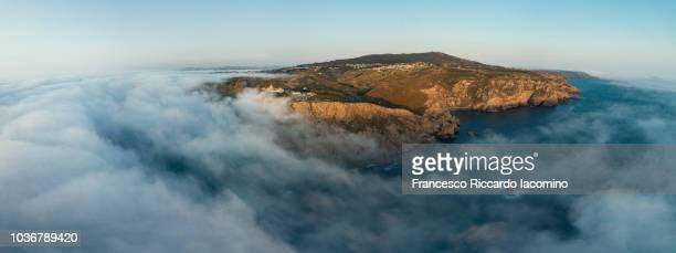 aerial view of cabo da rocha with fog on ocean, portugal - iacomino portugal foto e immagini stock