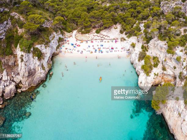 aerial view of cala macarelleta beach crowded, spain - balearic islands stock pictures, royalty-free photos & images