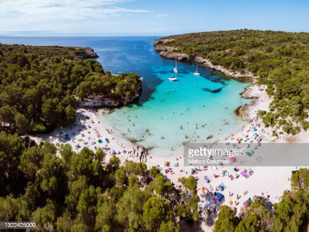 aerial view of cala turqueta beach, menorca, spain - busy stock pictures, royalty-free photos & images