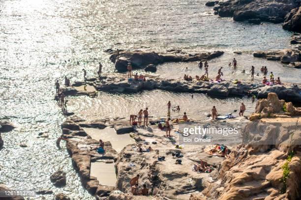 aerial view of calafuria rock beach with roman bath, livorno, tuscany. italy - pastore maremmano foto e immagini stock