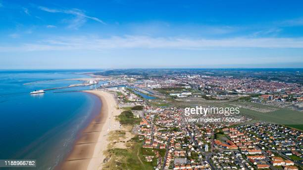 aerial view of calais city and harbor, france - calais stock pictures, royalty-free photos & images