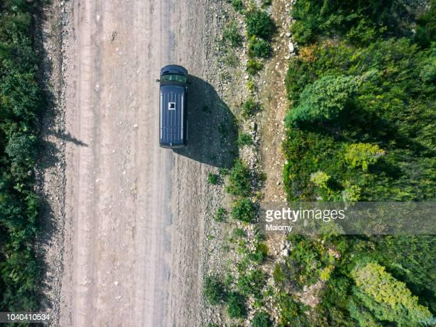 aerial view of camper van driving through tree area on denali highway. denali highway, usa, alaska. - paisajes de alaska fotografías e imágenes de stock