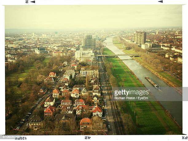 aerial view of canal passing through city - roman pretot stock pictures, royalty-free photos & images