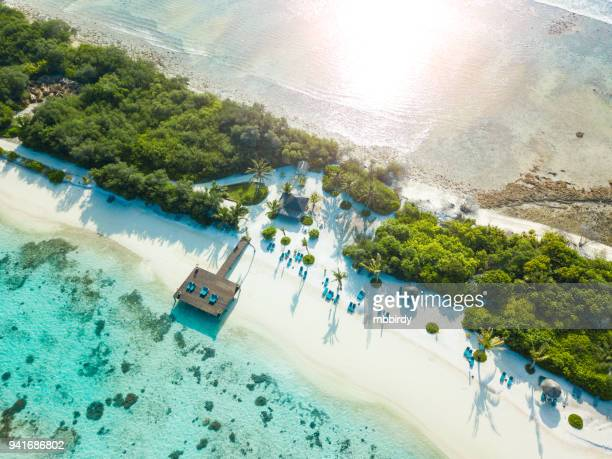 aerial view of canareef resort maldives, herathera island, addu atoll - tourist resort stock pictures, royalty-free photos & images