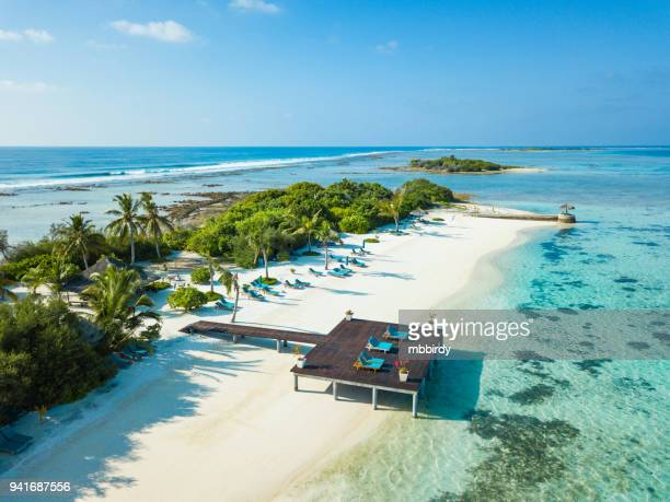 aerial view of canareef resort maldives, herathera island, addu atoll - atoll stock pictures, royalty-free photos & images