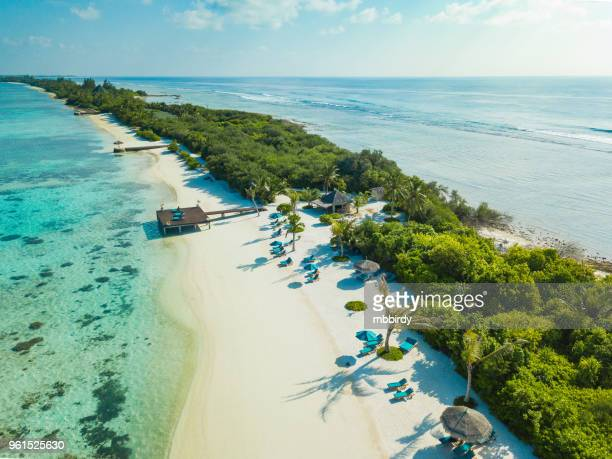aerial view of canareef resort maldives, herathera island, addu atoll - maldives stock pictures, royalty-free photos & images