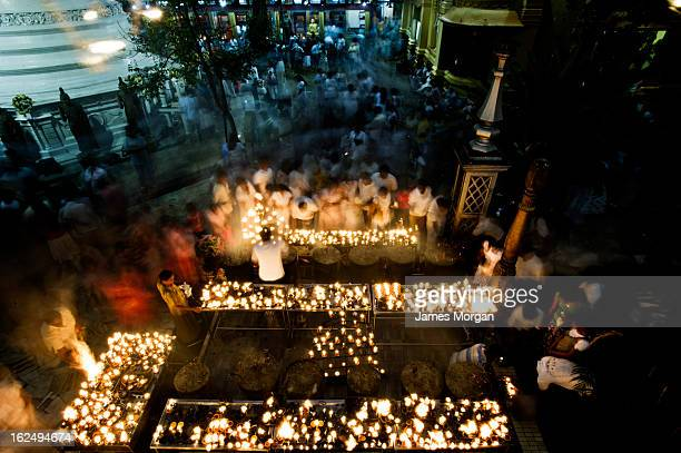 Aerial view of candles and worshippers at temple