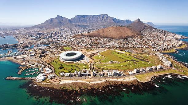 aerial view of cape town stadium amidst sea and mountains in city picture