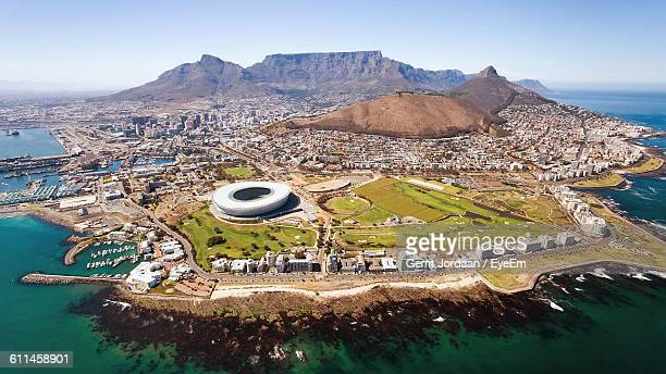 aerial view of cape town stadium amidst sea and mountains in city - republik südafrika stock-fotos und bilder