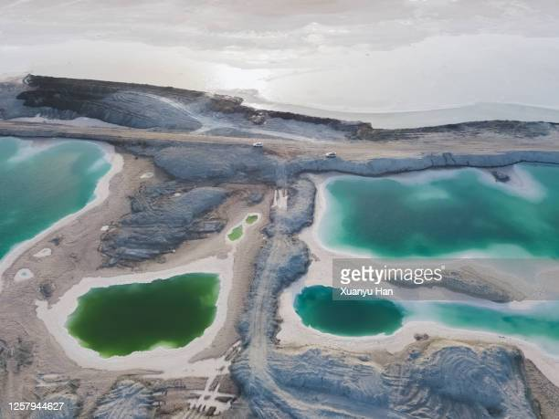 aerial view of car driving next to the salt lake - ソルトポンド ストックフォトと画像
