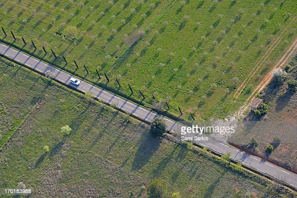 Aerial view of car on a countryside road