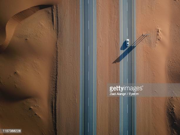 aerial view of car on road - drone point of view stock pictures, royalty-free photos & images