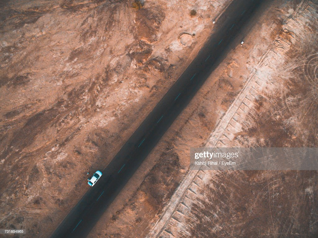 Aerial View Of Car Park On Road By Barren Landscape : Stock Photo