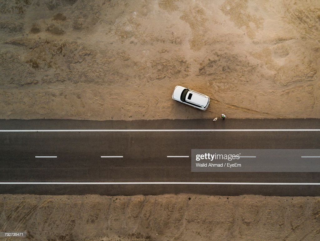 Aerial View Of Car Parked By Road : Stock Photo