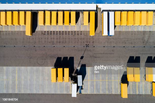 aerial view of cargo containers and distribution warehouse - container stock pictures, royalty-free photos & images
