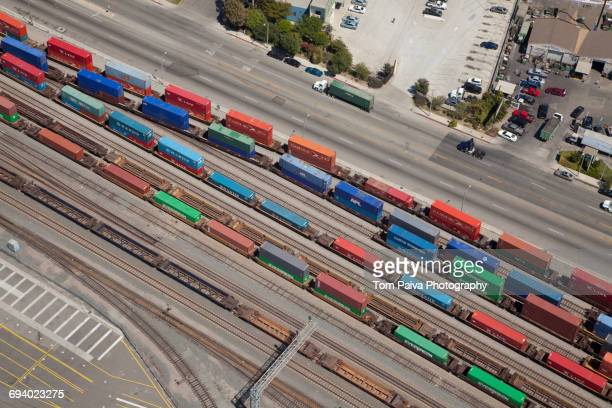 aerial view of cargo containers on railroad tracks - shunting yard stock photos and pictures