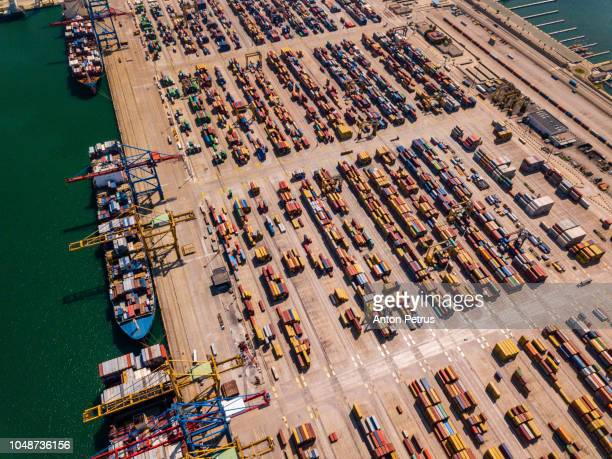 Aerial view of cargo ship, cargo container in warehouse harbor at Valencia