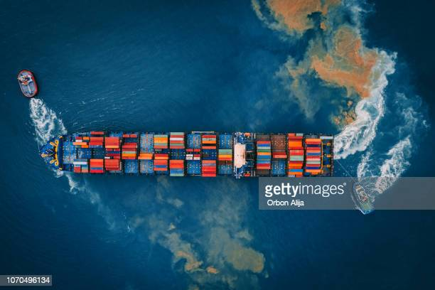 aerial view of cargo ship, cargo container in warehouse harbor. - cargo ship stock pictures, royalty-free photos & images